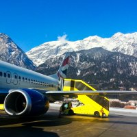 Austrian alps as a backdrop, boarding a British Airways aircraft